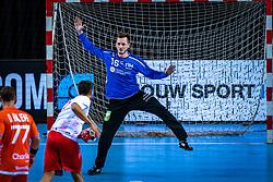 The Dutch handball player Mark van den Beucken in action during the European Championship qualifying match against Turkey in the Topsport Center Almere.