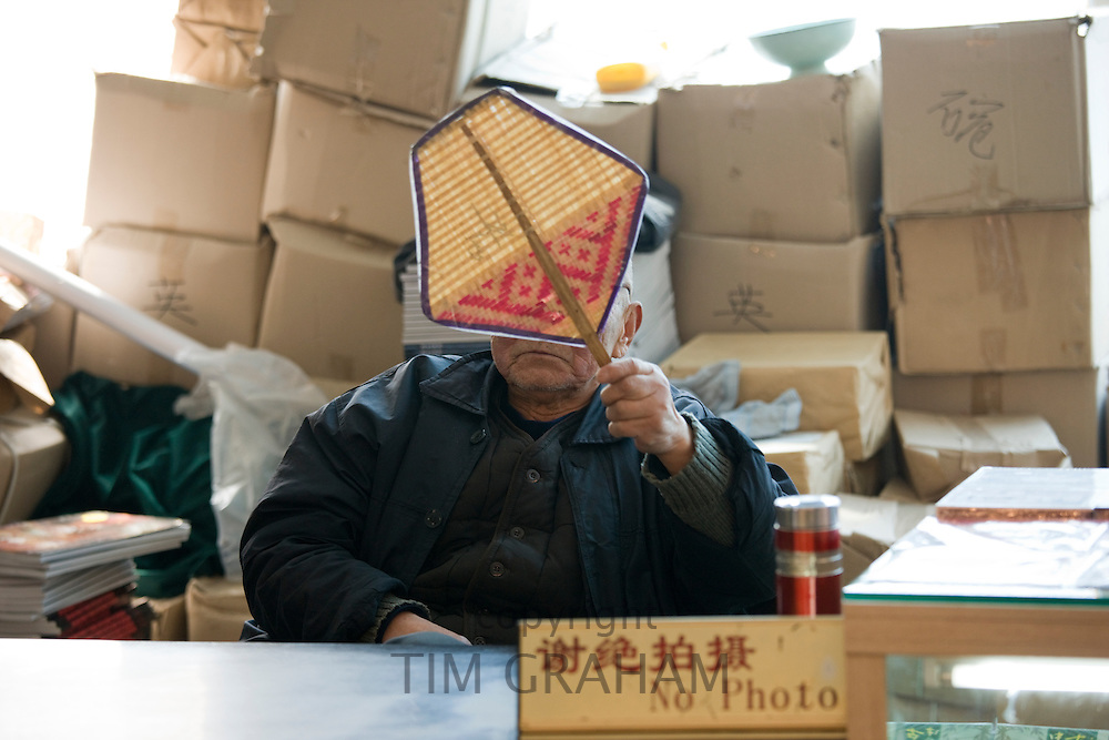 Mr Yang Peiyan, the farmer who found the Terracotta Warriors, in the gift shop at Qin Museum, Xian