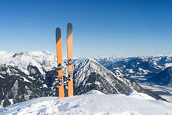 Skis in snow against sky