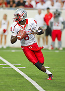 Sep 10, 2011; Little Rock, AR, USA; New Mexico Lobos quarterback Tarean Austin (8) looks to make a pass during the first half of a game against the New Mexico Lobos at War Memorial Stadium.  Mandatory Credit: Beth Hall-US PRESSWIRE
