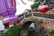 Traditional stone arch bridge Shantang canal area in Suzhou, China.