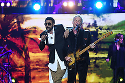 Sting and Shaggy perform at the Royal Albert Hall in London for a star-studded concert to celebrate the Queen's 92nd birthday.