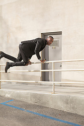 March 14, 2017 - Young man jumping over rail (Credit Image: © Image Source via ZUMA Press)