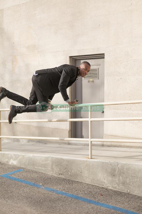 March 14, 2017 - Young man jumping over rail (Credit Image: © Image Source via ZUMA Press)