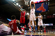 DALLAS, TX - JANUARY 21: Cannen Cunningham #15 of the SMU Mustangs grabs a rebound against the Rutgers Scarlet Knights on January 21, 2014 at Moody Coliseum in Dallas, Texas.  (Photo by Cooper Neill/Getty Images) *** Local Caption *** Cannen Cunningham