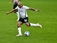 Football - 2020 / 2021 Sky Bet Championship - Swansea City vs Cardiff City - Liberty Stadium<br /> <br /> André Ayew Swansea City shoots at goal in the South Wales local derby match<br /> <br /> COLORSPORT/WINSTON BYNORTH