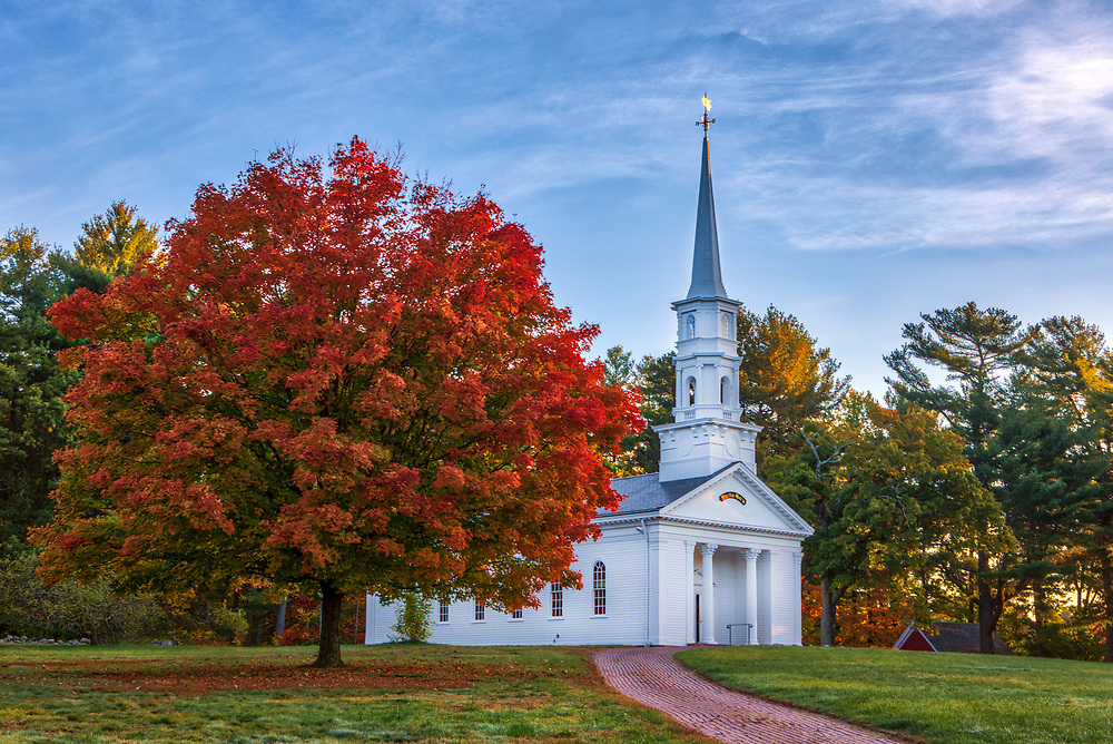 New England fall foliage at the white steeple Martha-Mary Chapel at the Wayside Inn Historic District in Sudbury, Massachusetts.<br /> <br /> Massachusetts white steeple Martha Mary Chapel fall foliage photos are available as museum quality photo, canvas, acrylic, wood or metal prints. Wall art prints may be framed and matted to the individual liking and interior design decoration needs:<br /> <br /> https://juergen-roth.pixels.com/featured/massachusetts-peak-fall-foliage-colors-at-the-martha-mary-chapel-juergen-roth.html<br /> <br /> Good light and happy photo making!<br /> <br /> My best,<br /> <br /> Juergen