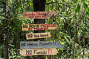 Signs listing the rules at the El Capulin Monarch Butterfly Biosphere Reserve in Macheros, Mexico. Each year millions of Monarch butterflies mass migrate from the U.S. and Canada to the Oyamel fir forests in central Mexico. The signs tell visitors to keep quiet, don't touch the butterflies, don't leave trash and don't feed the monarchs.