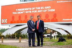 © Licensed to London News Pictures. 09/06/2016. London, UK. Crystal Palace FC co-owner JEREMY HOSKING and Former Executive Director of the Grassroots Out ALEX DEANE and Top City investor unveil their new EU referendum campaign 'Brexit Express' at Vauxhall Cross with the first of a series of billboard advertisements to be launched across major sites across the country on 9 June 2016. Photo credit: Tolga Akmen/LNP