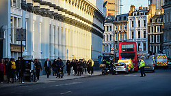© Licensed to London News Pictures. 29/11/2019. LONDON, UK.  Police attend the scene on Southwark Street after the Metropolitan police reported that one man in the area has been shot and the incident is being treated as terror related.  Office workers and local people are currently being evacuated.  Photo credit: Stephen Chung/LNP