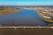 Nederland, Overijssel, Deventer, 20-01-2011. IJsselbrug in de A1 over de IJssel bij hoogwater, direct ten zuiden van Deventer (aan de horizon). Goed te zien is hoe de rivier bij Deventer een flessenhals vormt..Bottle neck of the river IJssel near the (Hansa) city of Deventer. High water..luchtfoto (toeslag), aerial photo (additional fee required).copyright foto/photo Siebe Swart