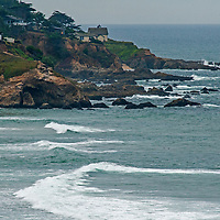 Houses surround a lighthouse on the Pacific Coast in Montara, California.