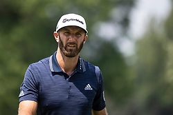 August 5, 2018 - Akron, OH, U.S. - AKRON, OH - AUGUST 05:   Dustin Johnson (USA) looks on after his putt on the fifth green during the final round of the World Golf Championships - Bridgestone Invitational on August 5, 2018 at the Firestone Country Club South Course in Akron, Ohio. (Photo by Shelley Lipton/Icon Sportswire) (Credit Image: © Shelley Lipton/Icon SMI via ZUMA Press)