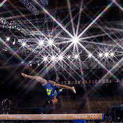 TOKYO, JAPAN - JULY 29: Rebeca Andrade of Brazil performs her routine on the balance beam during her silver medal performance in the All-Around Final for Women at Ariake Gymnastics Centre during the Tokyo 2020 Summer Olympic Games on July 29, 2021 in Tokyo, Japan. (Photo by Tim Clayton/Corbis via Getty Images)<br /> <br /> (Note to editors: A special effects starburst filter was used in the creation of this image)