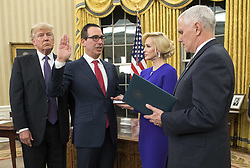 February 13, 2017 - Washington, District of Columbia, United States of America - Seven Mnuchin, accompanied by his fiancee Louise Linton, is sworn-in as United States Secretary of the Treasury by Vice President Mike Pence while President Donald Trump watches, during a ceremony at the White House in Washington, D.C. on February 13, 2017. Mnuchin was confirmed by the Senate 54-47. .Credit: Kevin Dietsch / Pool via CNP (Credit Image: © Kevin Dietsch/CNP via ZUMA Wire)
