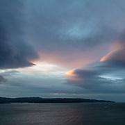 Last light above Tobermory on Mull from Auliston Point, Morvern, Highland, Scotland.