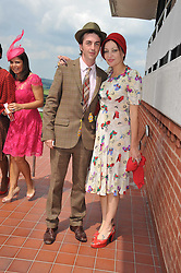 PEARL LOWE and DANNY GOFFEY at the 3rd day of the 2011 Glorious Goodwood Racing Festival - Ladies Day at Goodwood Racecourse, West Sussex on 28th July 2011.