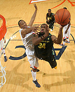 Dec. 17, 2010; Charlottesville, VA, USA; Oregon Ducks forward Joevan Catron (34) shoots the ball in front of Virginia Cavaliers forward Akil Mitchell (25) during the game at the John Paul Jones Arena. Virginia won 63-48. Mandatory Credit: Andrew Shurtleff