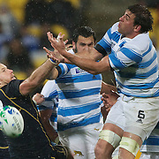 Julio Farias Cabello, Argentina, challenges Graeme Morrison, Scotland for the ball during the Argentina V Scotland, Pool B match at the IRB Rugby World Cup tournament. Wellington Regional Stadium, Wellington, New Zealand, 25th September 2011. Photo Tim Clayton...