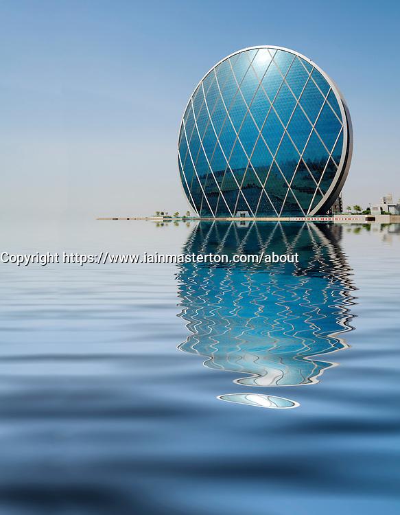 Unusual modern architecture of headquarters building for Aldar in Abu Dhabi United Arab emirates UAE