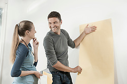 Couple choosing wallpaper for their new home, Bavaria, Germany