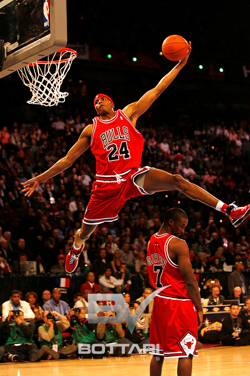 LAS VEGAS, NV - FEBRUARY 17: Tyrus Thomas of the Chicago Bulls leaps over Ben Gordon while attempting a dunk during the Sprite Slam Dunk Competition as part of NBA All-Star Weekend on February 17, 2007 at the Thomas and Mack Center in Las Vegas, Nevada.. NOTE TO USER:User expressly acknowledges and agrees that, by downloading and/or using this Photograph, user is consenting to the terms and conditions of the Getty Images License Agreement. Mandatory Copyright Notice: Copyright 2007 NBAE (Photo by Jeff Bottari/NBAE via Getty Images).
