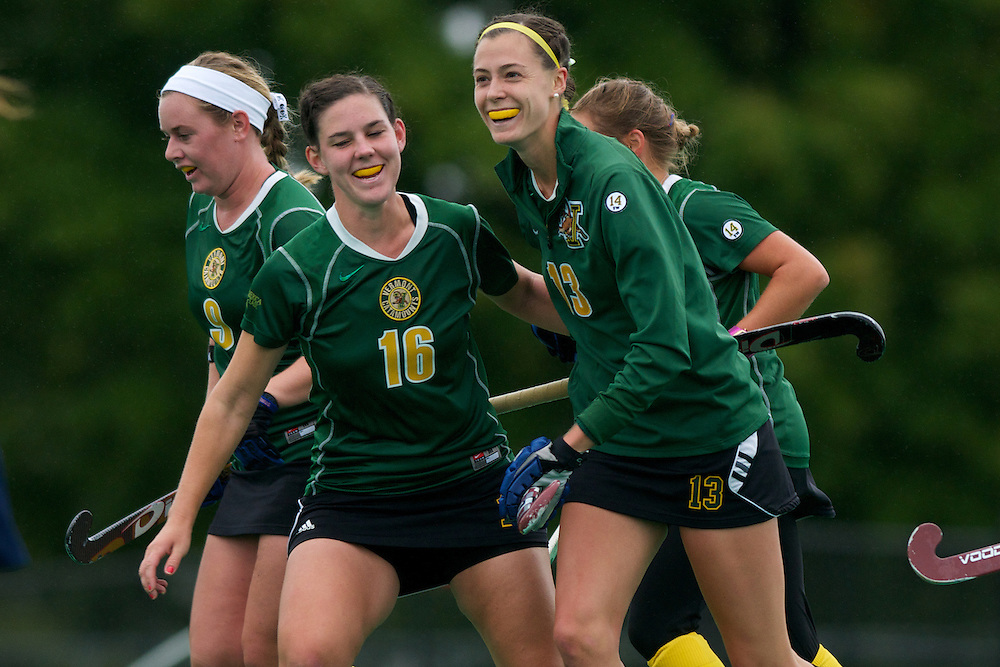 Catamounts midfielder Sally Snickenberger (16) congratulates Catamounts midfielder Alana Izzo (13) after scoring a goal during the women's field hockey game between the Maine Black Bears and the Vermont Catamounts at Moulton/Winder Field on Saturday afternoon September 29, 2012 in Burlington, Vermont.