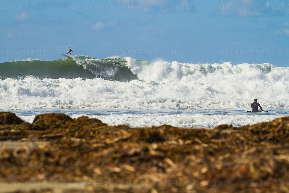 Surfer kicks out of a large wave surfing in Dana Point, California. Photo by Robert Zaleski/rzcreative.com