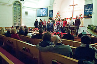 The Evangelical Baptist Church hosted two open Christmas services for the Christmas in the Village through downtown Laconia on Friday evening.   (Karen Bobotas/for the Laconia Daily Sun)