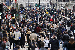 © Licensed to London News Pictures. 12/12/2020. London, UK. Christmas shoppers flock to Regent Street which has been pedestrianised for the day. Experts are warning that London should be placed in tier three now to avoid a rise is coronavirus deaths over the Christmas period. Photo credit: Peter Macdiarmid/LNP