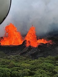 Handout photo taken on May 21, 2018 of KÄ«lauea Volcano — Lava Fountain (Fissure 22). Helicopter overflight of KÄ«lauea Volcano's Lower East Rift Zone shows fountaining at Fissure 22. Photo by usgs via ABACAPRESS.COM