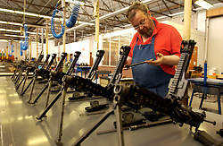 HERSTAL, BELGIUM - APRIL-11-2003 - Machine guns are assembled by hand at the FN Herstal weapons fabrication plant near Liege, Belgium. .(Photo © Jock Fistick)