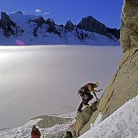 BAFFIN ISLAND, Nunavut, Canada. Alex Lowe starts up first pitch of month-long climb on north face of Great Sail Peak, above Stewart Valley.