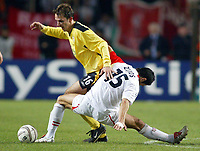 Fotball<br /> Champions League 2004/05<br /> Monaco v Liverpool<br /> 23. november 2004<br /> Foto: Digitalsport<br /> NORWAY ONLY<br /> Monaco's Andreas Zikos gets tangled up with Liverpool's Dietmar Hamann