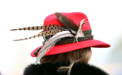 Racegoer wears a red hat prior to the start of the action on the Gold Cup Friday of the 2018 Cheltenham Festival at Cheltenham Racecourse.