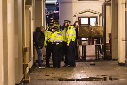London, January 01 2018. Police question a man after an altercation in Piccadilly as revellers in London's West End enjoy New Year's Eve. © SWNS