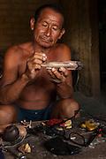 Balata Artesan - George Tancredo MODEL GYA#2<br /> Balata or Bullet Wood Tree is bled for natural latex<br /> Nappi<br /> Rupununi<br /> GUYANA<br /> South America