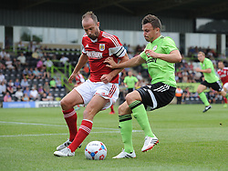 Bristol City's Louis Carey and Forest Green Rovers Andrew Mangan - Photo mandatory by-line: Dan Rowley/JMP  - Tel: Mobile:07966 386802 20/07/2013 -Forest Green Rovers  vs Bristol City  - SPORT - FOOTBALL - Forest Green Rovers - Bristol city  -