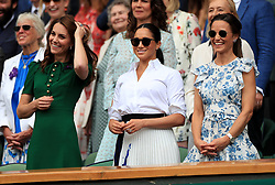 The Duchess of Cambridge and The Duchess of Sussex wit Pippa Middleton on day twelve of the Wimbledon Championships at the All England Lawn Tennis and Croquet Club, Wimbledon.