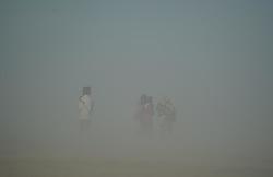 June 28, 2017 - Allahabad, Uttar Pradesh, India - Allahabad: Piligrims walks trough dust storm at Sangam, the confluence of River Ganga, Yamuna and Mythological Saraswati, in Allahabad on 28 june 2017. Photo by prabhat kumar verma (Credit Image: © Prabhat Kumar Verma via ZUMA Wire)