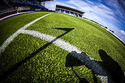 The corner flag and photographer cast a shadow on new pitch at The Falkirk Stadium,  for the Scottish Championship game v Hamilton. The woven GreenFields MX synthetic turf and the surface has been specifically designed for football with 50mm tufts compared with the longer 65mm which has been used for mixed football and rugby uses.  It is fully FFA two star compliant and conforms to rules laid out by the SPL and SFL.<br /> ©Michael Schofield.