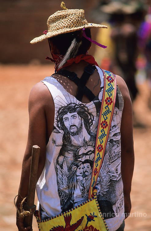 """The """"Judios"""" paints their bodies simbolysing  the Evil forces and struggles in the streets looking for Jesus. Coras are a small indigenous people living scattered in the mountains of Sierra Madre Central in Mexican state of Nayarit. The Coras still follows their traditions, protecting in a very strong way their secret rites, that anthropologists believe the most interesting of Central America for their synchretism. The Holy Week, the most important religious event of the year, is characterized with impressive ceremonies. The catholic priest doesn't partecipate and the Black Centurion is the captain of Judea, the ?Jews?, the devil's militia looking for Jesus Christ to kill him. Violence is a essential part of the ceremonies and somebody can be killed in the struggles with wood swords."""