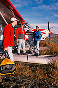 Alaska. Kenai Peninsula. Fisherman standing by plane on on a fly in fishing trip. PLEASE CONTACT US FOR DIGITAL DOWNLOAD AND PRICING.