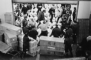 In the Island country of JAPAN, fish and seafood are the central focus of their culinary routine. The Tsukiji  Fish Markets in TOKYO process around 2,700 tons of fish a day handling more than 400 different types of seafood. The bustling marketplace comes to life in the early hours of the morning when the fish is inspected before the auctions start at around 5.30 a.m. Once bought the seafood is taken by the wholesalers back to their stalls in the markets, as well as heading off to restaurants and retailers .Almost all the fish eaten in TOKYO come from these markets. Plans to relocate the markets by 2012 are under way, a move prompted by the ageing buildings of the Tsukiji markets and the larger area of the new site at Toyosu.<br /> <br /> PIXS TAKEN......021221 (21ST DECEMBER 2002)<br /> Pic shows...Buyers bid against each other once the Auctions begin.