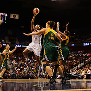 Kelsey Bone, Connecticut Sun, shoots over  Jenna O'Hea,  and Camille Little, (right), during the Connecticut Sun Vs Seattle Storm WNBA regular season game at Mohegan Sun Arena, Uncasville, Connecticut, USA. 23rd May 2014. Photo Tim Clayton