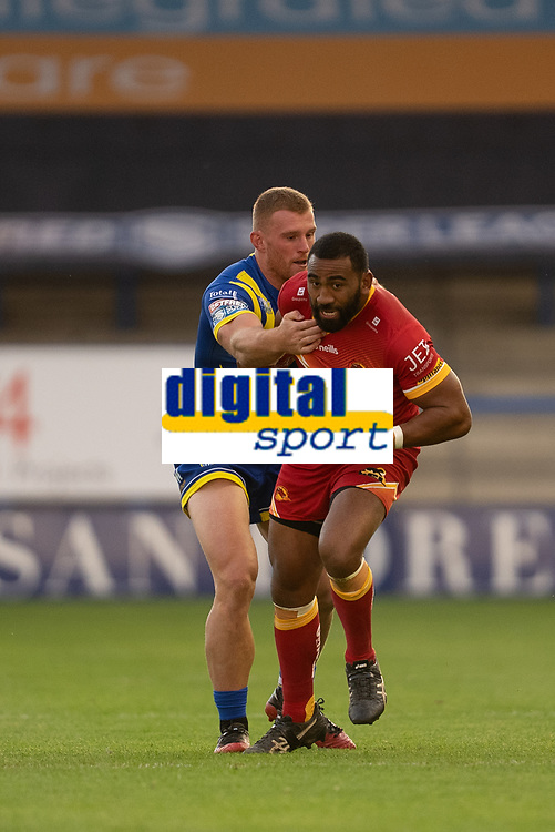 Rugby League - 2020 Super League - Round 13 - Warrington Wolves vs Catalan Dragon<br /> <br /> Catalans Dragons's Samisoni Langi is tackled,   at the Halliwell Jones Stadium, Warrington<br /> <br /> <br /> COLORSPORT/TERRY DONNELLY
