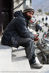 Spoke and Dagger's Chris Drew on a chai stop in Jomsom on Motorcycle Sherpa's Ride to the Heavens motorcycle adventure in the Himalayas of Nepal. On the fifth day of riding, we went from Muktinath to Tatopani. Friday, November 8, 2019. Photography ©2019 Michael Lichter.