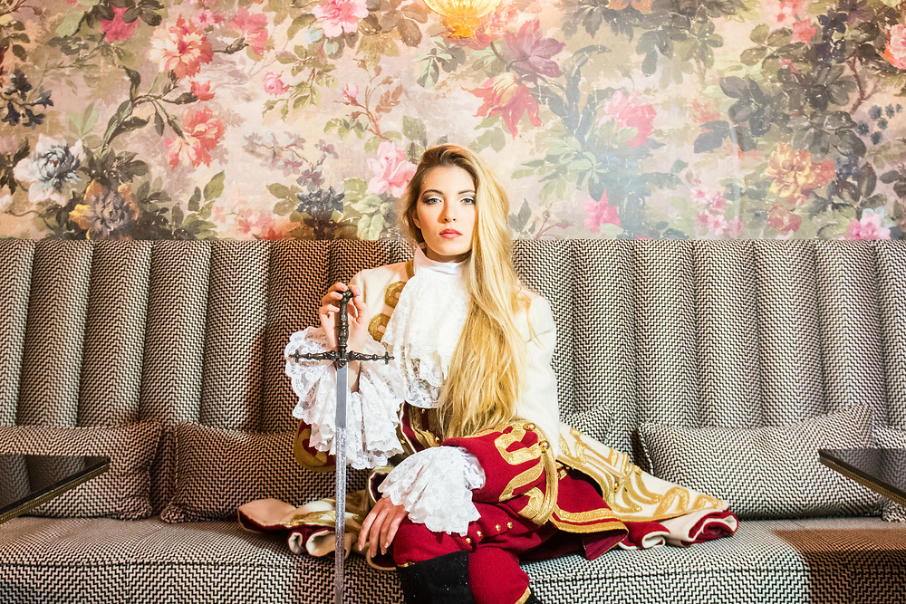 """Venice, February 2019<br /> Model Anna Bardi wears a """"Lady Oscar"""" dress, faithful reproduction of uniform by General Austrian, worn by the famous heroine in the first version of the manga.<br /> The theme for the 2019 edition of Venice Carnival is 'Venice, the oldest city of the future!' and will run from 16th of February to 5th of March 2019."""