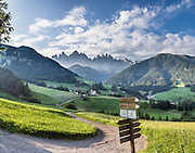 Views of the Geisler/Odle Group and a church in St. Magdalena (Santa Maddalena) village are iconic of the Dolomites mountains. See the valley and municipality of Funes (Villnöss) in Trentino-Alto Adige/Südtirol (South Tyrol), Italy. Enjoy great hiking here in the vast Nature Park of Parco Naturale Puez-Odle (German: Naturpark Puez-Geisler; Ladin: Parch Natural Pöz-Odles). The Dolomites are part of the Southern Limestone Alps, Europe. UNESCO honored the Dolomites as a natural World Heritage Site in 2009. This panorama was stitched from 3 overlapping photos.