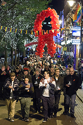 "© Licensed to London News Pictures . 1/12/2012 . Manchester , UK . Hundreds mark World AIDS Day with a candlelit procession through Manchester City Centre 's "" Gay Village "" . Campaigners are urging people to take regular HIV tests . It's estimated as many as 1 in 4 HIV positive people do not know they are infected with the virus . Photo credit : Joel Goodman/LNP"